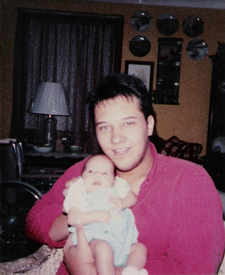 Frank holding his daughter before chronic pain started